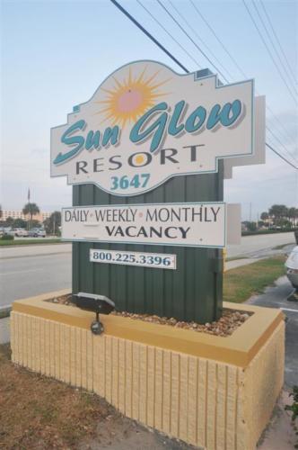 Sun Glow Resort Sign